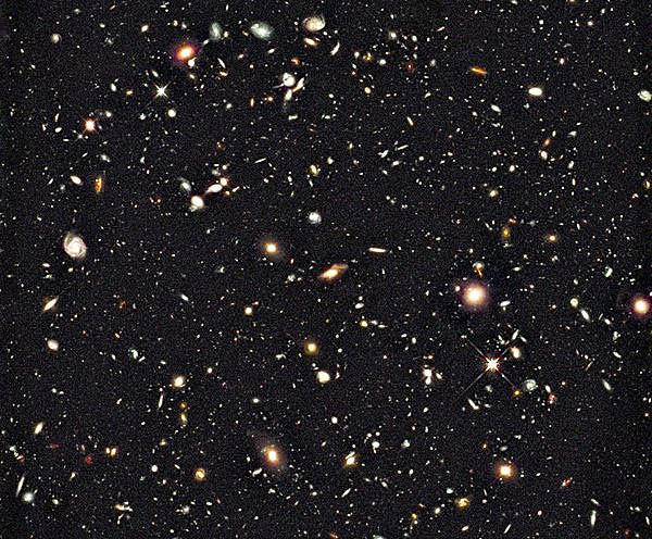 A Hubble Space Telescope image shows the deepest image of the universe ever taken in near-infrared light. The faintest and reddest objects are galaxies that formed 600 million years after the Big Bang.