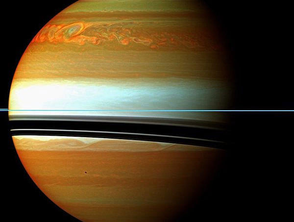 NASA's Cassini spacecraft tracked the aftermath of a rare, huge storm on the planet Saturn. The clouds depicted in red, orange and green indicate the tail end of the 2010-2011 tempest.
