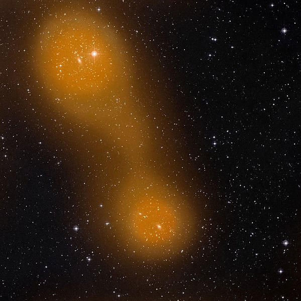Two galaxy clusters are connected by a bridge of hot gas in an image from ground-based telescopes and the Planck satellite.