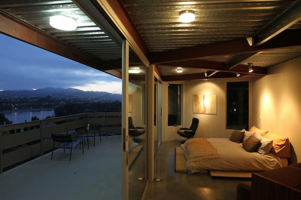 At the Tattuplex, the most impressive view isn't from the living room but rather the master bedroom, where floor-to-ceiling sliding Fleetwood glass doors open onto a wide terrace with unimpeded views of Silver Lake Reservoir.