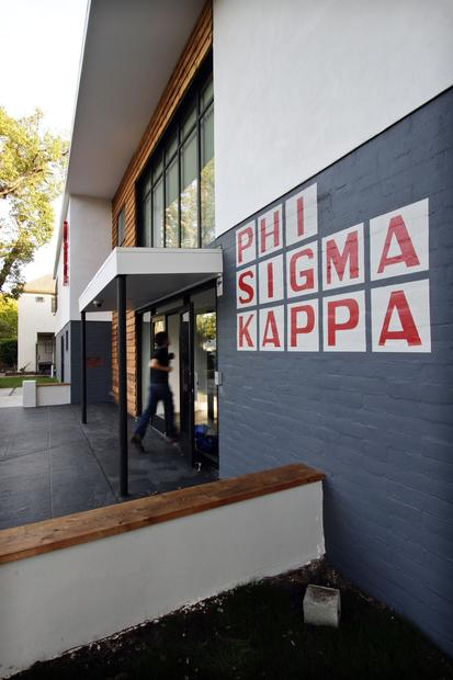 "Among the biggest changes at Phi Sigma Kappa: A new entry featuring two-story-tall windows, bringing more light into the building. Although fraternity culture often centers on closely guarded secrets, the reborn chapter wanted its house to reflect a new sensibility. Transparency was the key word. ""We wanted it to be more welcoming,"" junior Elias Bashoura said. ""We wanted a new model from what had previously been seen on the Row."""