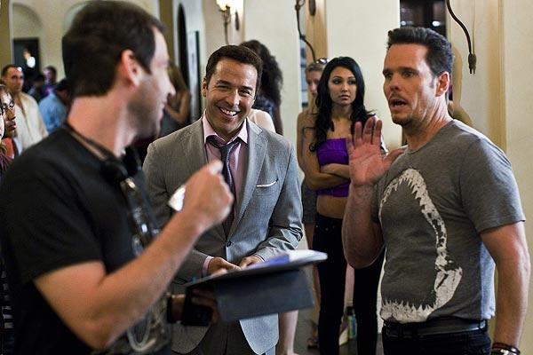 Doug Ellin, left, talks over a scene with Jeremy Piven, center, playing Ari Gold, and Kevin Dillon.