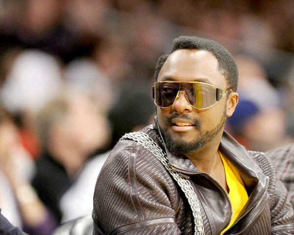 Will.i.am checks out the sights courtside at the Lakers-Heat game on Christmas Day.