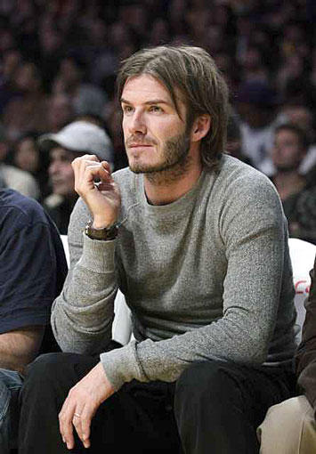 Taking a break from the pitch, David Beckham watches the Lakers play the Pistons at Staples Center.