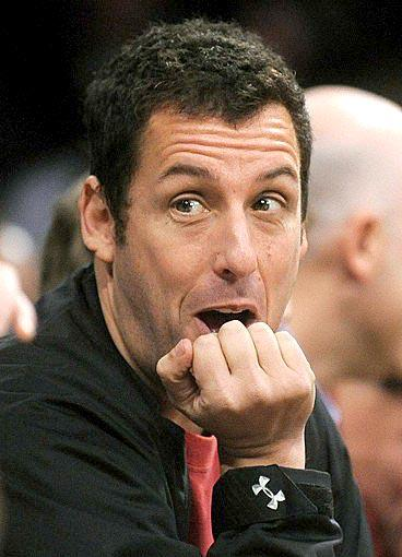 Adam Sandler reacts to the play during the second half of the Lakers-Celtics game at Staples Center.