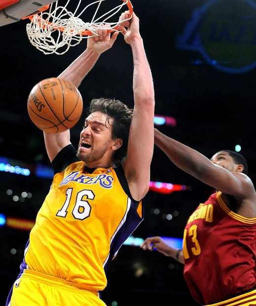 Cavaliers power forward Tristan Thompson is too late to prevent a dunk by Lakers power forward Pau Gasol in the first half Friday night at Staples Center.