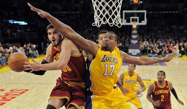 Cleveland forward Omri Casspi has his shot challenged by Lakers center Andrew Bynum in the first half Friday night at Staples Center.