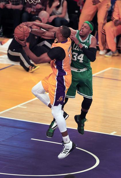 Celtics forward Paul Pierce tries to block a shot by Lakers center Dwight Howard in the first half Wednesday night.
