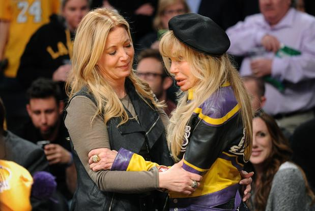 Jeanie Buss, daughter of late Lakers owner Jerry Buss and executive vice president of business operations, and Dyan Cannon console each other before the game Wednesday night at Staples Center.