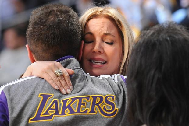 Jeanie Buss, Lakers executive vice president of business operations and daughter of longtime owner Jerry Buss, is consoled by a friend before the game against the Celtics on Wednesday night at Staples Center.