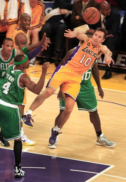 Lakers point guard Steve Nash makes a pass after driving into a wall of Celtics defenders in the first half Wednesday night.