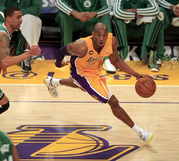 Lakers guard Kobe Bryant tries to drive away from Celtics guard Courtney Lee in the second half Wednesday night.