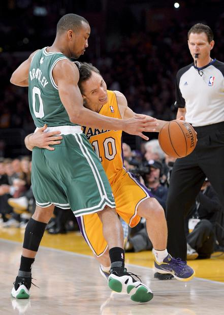 Lakers point guard Steve Nash tries to drive around Celtics guard Avery Bradley in the first half Wednesday night.