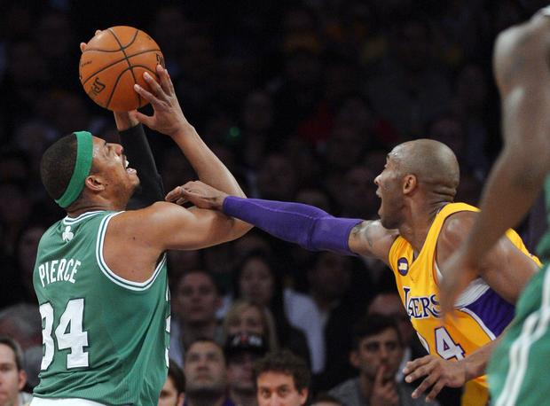 Lakers guard Kobe Bryant fouls Celtics forward Paul Pierce during play in the first half Wednesday night.