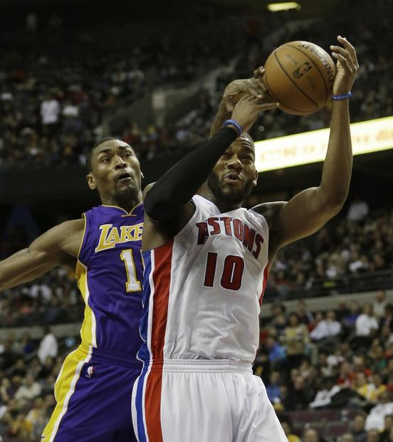 Lakers forward Metta world Peace knocks the ball from Piston center Greg Monroe in the second half Sunday.