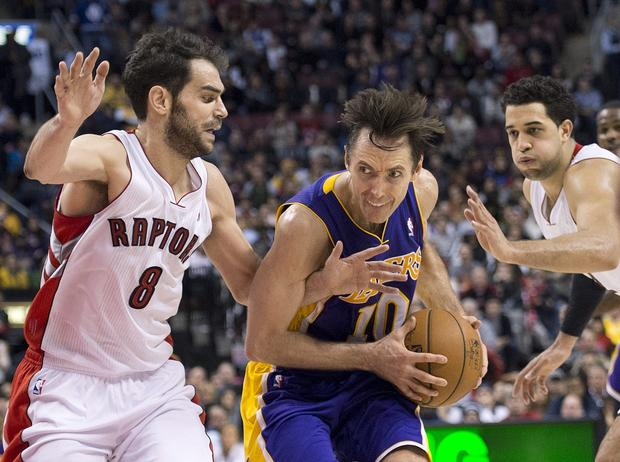 Lakers point guard Steve Nash drives past Raptors guard Jose Calderon, left, and forward Landry Fields in the second half Sunday.