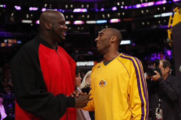 Former Laker Shaquille O'Neal talks with Kobe Bryant before the game.