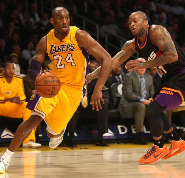 Lakers guard Kobe Bryant drives around Phoenix guard P.J. Tucker.