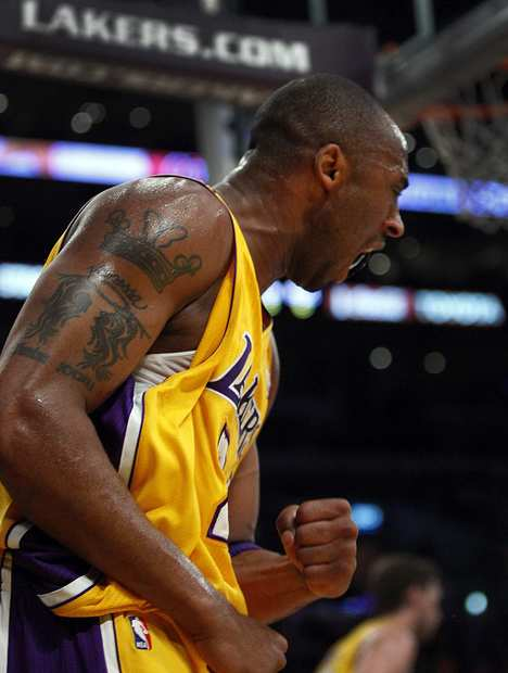 Lakers guard Kobe Bryant reacts after getting fouled on a shot during the game Friday night against the Suns.