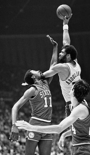 "The setting: With 33 seconds left in a tie game, <a href=""http://projects.latimes.com/lakers/player/kareem-abdul-jabbar/"">Abdul-Jabbar</a> scored on a dunk and was fouled by Julius Erving. Abdul-Jabbar made the free throw and the Lakers won, 108-103, at the Forum.<br> <br> The significance: Abdul-Jabbar sprained an ankle late in the third quarter and limped to the locker room. He returned at the start of the fourth quarter and scored 14 of his 40 points in the final 12 minutes. The league's most valuable player missed Game 6 in Philadelphia, but Magic Johnson's heroics led the Lakers to a 123-107 victory and the title.<br> <br> Note: This picture shows an earlier shot from the same game."