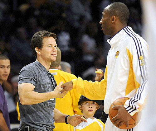 Lakers guard Kobe Bryant greets actor Mark Wahlberg before Game 2 on Sunday at Staples Center.