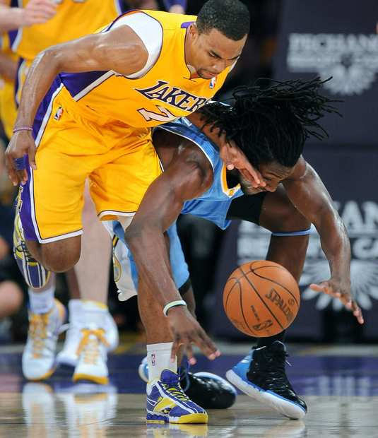 Lakers point guard Ramon Sessions and Nuggets forward Kenneth Faried collide as they chase down a loose ball during their game Friday night at Staples Center.