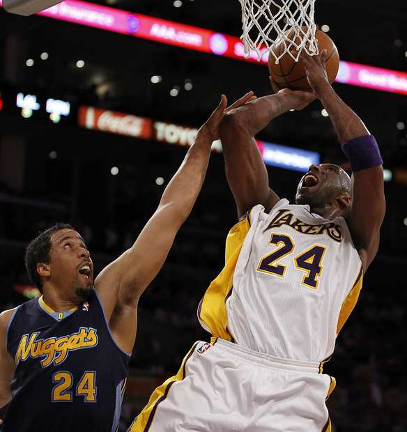 Lakers guard Kobe Bryant, who finished with a game-high 31 points, is fouled by Nuggets point guard Andre Miller in the fourth quarter Sunday afternoon at Staples Center during Game 1 of their first-round playoff series.