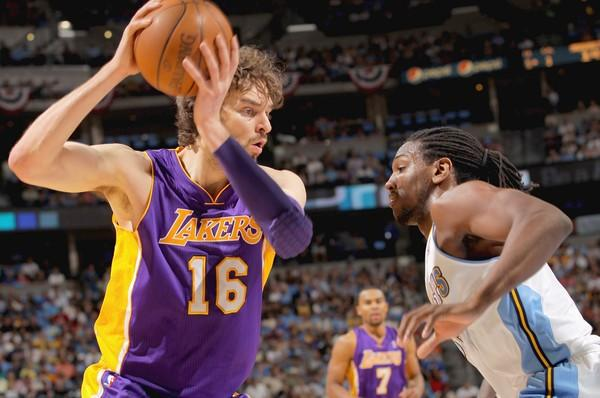 Lakers power forward Pau Gasol sizes up Nuggets forward Kenneth Faried during play in the first half Friday night in Denver.