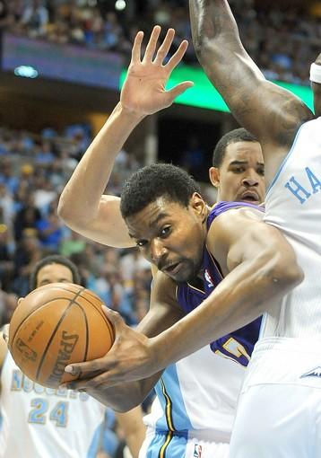 Lakers center Andrew Bynum tries to work his way around the double-team defense of Nuggets big men JaVale McGee and Al Harrington in the first half of Game 3 on Friday night in Denver.