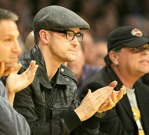 Singer Justin Timberlake applauds the efforts of the Lakers during a 121-96 victory over the Portland Trail Blazers.