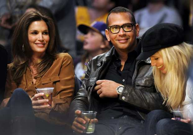 Model Cindy Crawford, left, baseball player Alex Rodriguez and former pro wrestler Torrie Wilson attend the Houston Rockets at Los Angeles Lakers NBA basketball game.