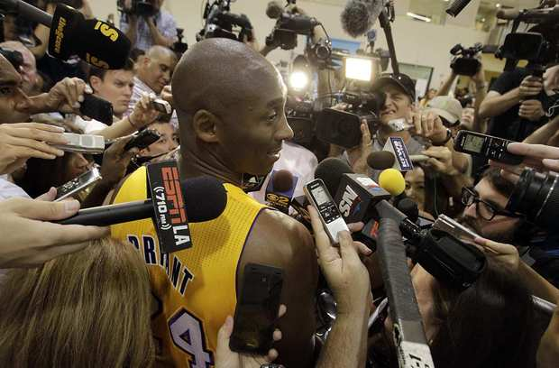 Kobe Bryant draws a crowd at the Lakers' media day at their El Segundo training facility.