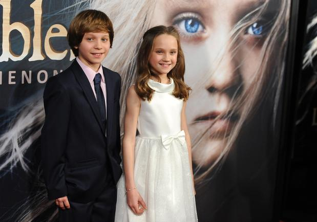 Daniel Huttlestone, who plays Gavroche, and Isabelle Allen, who portrays Young Cosette.