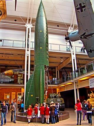 Schoolchildren on a field trip to the Imperial War Museum examine a German V2 rocket.