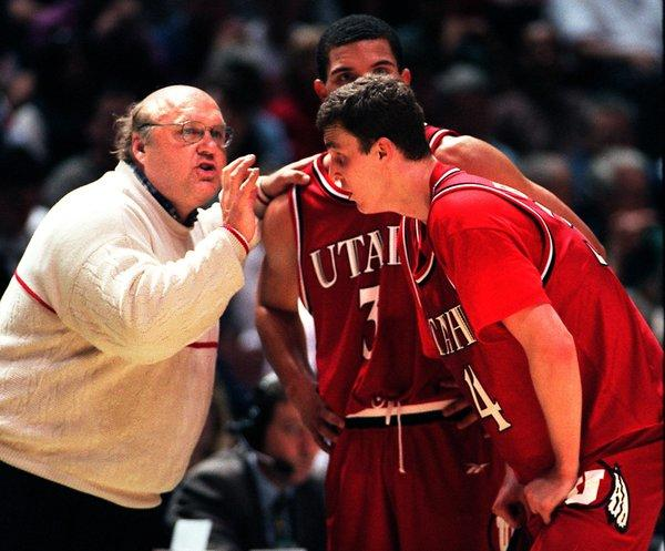 Utah Coach Rick Majerus instructs his players during a 1998 NCAA tournament game against Arizona.