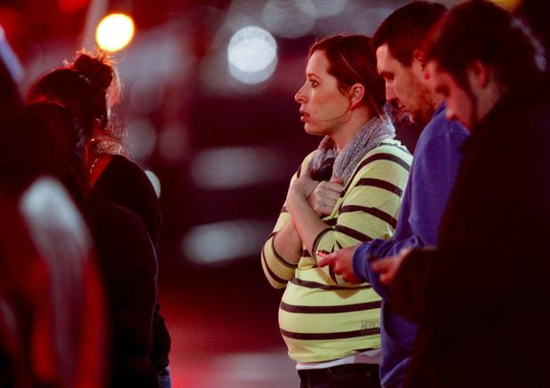 Onlookers gather outside Clackamas Town Center in Clackamas, Ore., where a shooting occurred.