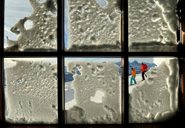 Skiers framed by a window at Panorama Lookout.