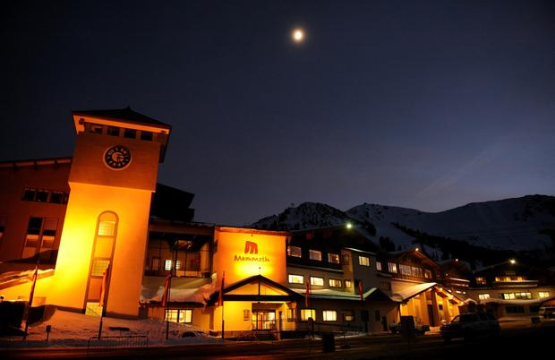 The moon shines bright over Main Lodge at Mammoth Mountain resort.