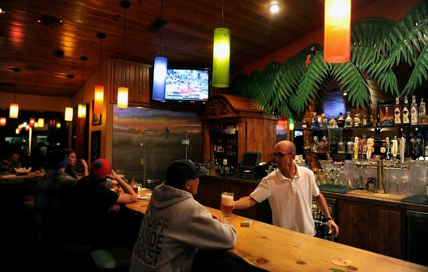 A bartender serves a customer at Roberto's Mexican Cafe in Mammoth Lakes.