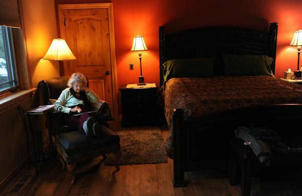 Dorothy Matthews, 90, relaxes in her room at the Swiss Chalet Bed & Breakfast Inn.