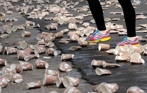 A runner passes through a sea of discarded paper cups during the 2013 L.A. Marathon.