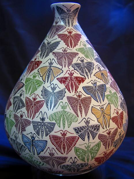 Butterflies decorate a pot by Hector Gallegos Jr. Many pieces from Mata Ortiz contain intricate images.