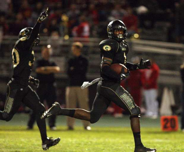 Narbonne linebacker Sidney Watkins, left, cheers on linebacker Keishawn Bierria as he retuurns a punt for a touchdown in the first quarter Friday night.