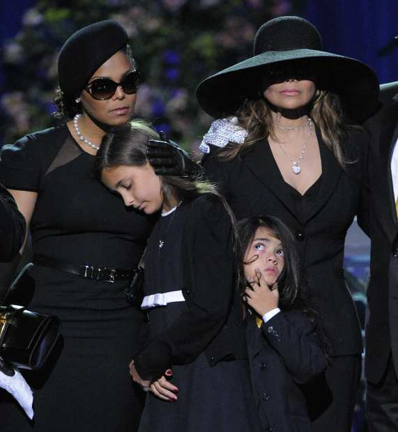 Janet Jackson, left, Paris Katherine Jackson, Prince Michael Jackson II and LaToya Jackson gather on stage during a memorial service for Michael Jackson at the Staples Center in Los Angeles on July 7, 2009.
