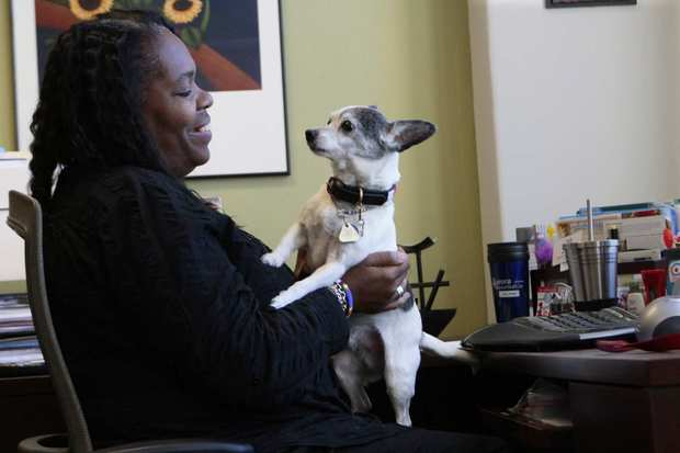 Keris Myrick plays with her therapy dog Steinbeck in her office at Project Return Peer Support Network in Commerce.