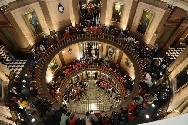 Protesters gather for a rally in the Michigan Capitol rotunda in Lansing.