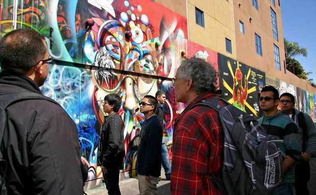 A class learns about the murals of Clarion Alley.