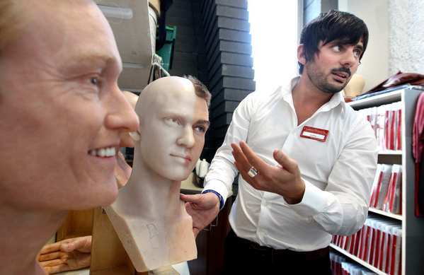 Colin Thomas, general manager of Madame Tussauds Hollywood, gives a tour of The Studio, which contains spare body parts for the museum's many celebrity wax sculptures. At left are figures of Conan O'Brien and  Justin Timberlake.