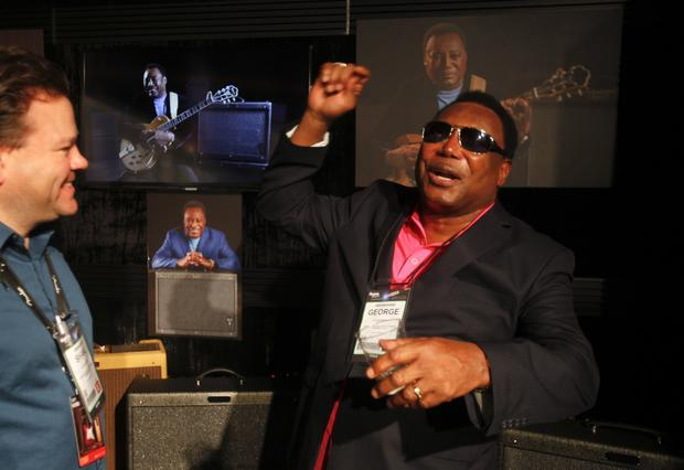 Grammy-winning jazz guitarist George Benson, right, talks to visitors in the Fender area where the Artist Signature Amplifiers are on display.