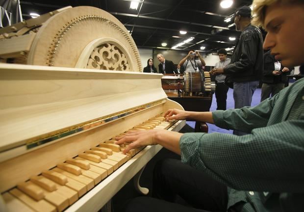 Antiquity Music demonstrates the wheelharp in its booth at the NAMM Show in Anaheim.